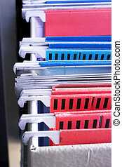 Filing cabinet 7 - Heap of coloured files in sliding filing...