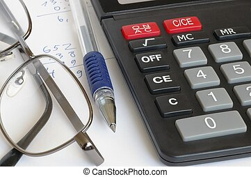 Calculations - Calculator, pen, glasses and some...