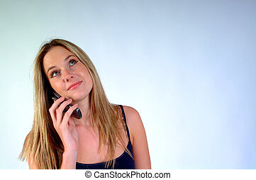 Awaiting a Call - Young woman with mobile / cellular phone...