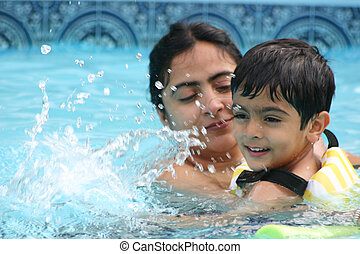 Family Fun - Mother and son having a great time in the pool....