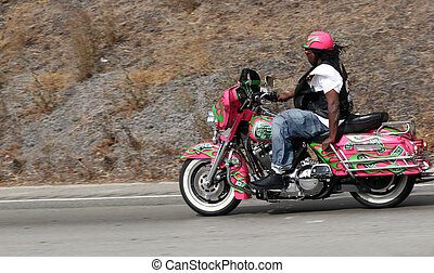 Biker on freeway - An african american guy riding on freeway