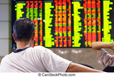 Stock market index - Asian man watching stock market index