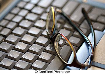 Thinking hard - Glasses on a laptop (selective DOF soft...