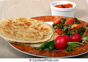 Indian Meal - Traditional Indian meal of flat breads rotis,...