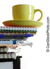 Office Overload - Pile of files with coffee cup