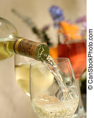 wine pour - pouring white wine into glass