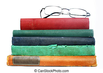 Study - Pile of old books and spectacles
