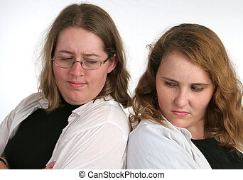 Sibling Rivalry - Two attractive teenaged sisters both over...