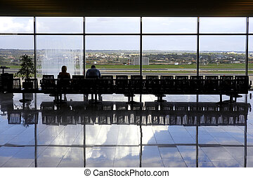 Two passengers waiting in airport lounge, palma airport,...