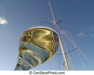 boat christening - glass of champagne in front of a yacht...