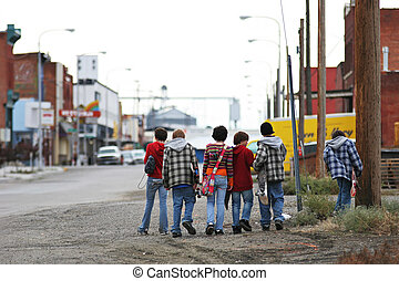 skater kids - group of young skater kids with skateboards...