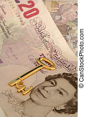 Key to wealth 3 - Gold key with pound symbol on top of...