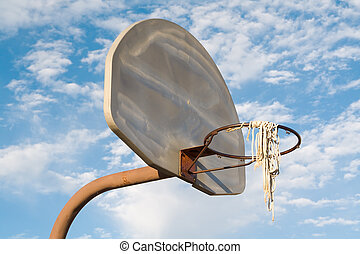 Inner City Urban Basketball - Vandalized, rusty urban...