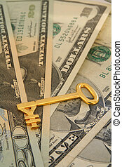 Forex - yen - A gold yen key lying on a fan of US dollars....