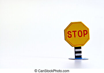 Stop Sign - Close up of a vintage tin toy stop sign on a...