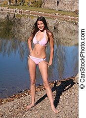 Bikini Girl - Smiling girl on beach with pretty pink bikini....