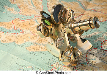 Map and sextant - A small sextant on a 1930s map of the...
