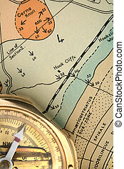 Geology - mapping 2 - An old compass resting on a 1920s...