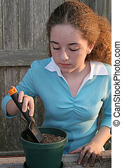 Ready To Plant - A student digging a hole in the dirt...