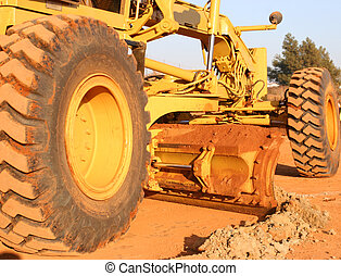 Heavy equipment scraping road top - Heavy earth moving...