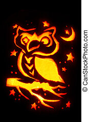 Jack-O-Lantern - image of an owl carved into a pumpkin