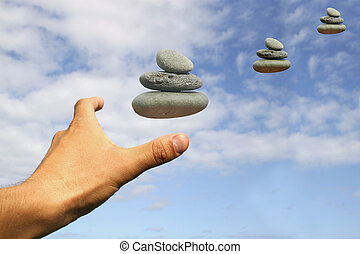 Searching for Peace - Hand and floating stone stacks
