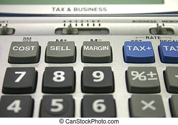 Tax Calculator - Closeup of tax and business calculator keys