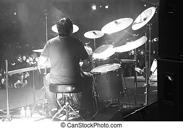 drummer in black and white - a drummer in action at a...