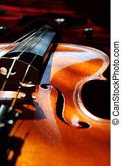 Violin on red velvet.