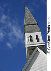 Church Steeple rising into the blue sky artistic blur