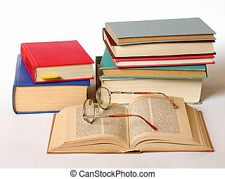 Books and glasses on white