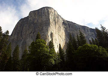 El Capitan in morning light - Looking up at the foot of El...