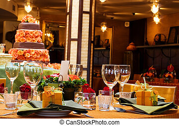 Wang Thai 15 - Table setting with wine glasses and a cake in...