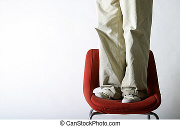 Feet on a Chair - A pair of feet on a red chair