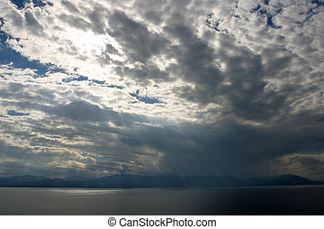 Gods touch - Light beams falling from between the clouds at...