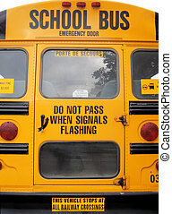 school buses - rear part of parked school buses