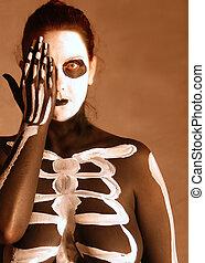 Spooky - woman in skeleton bodypaint