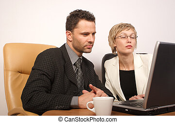 Business man & woman - Man and woman busy with office work