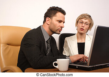 man woman coo work 2 - Man and woman busy with office work