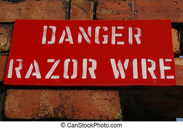 Razor Wire 01 - A warning sign denoting the danger of razor...