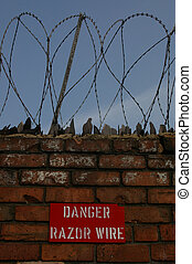Razor Wire 03 - Razor wire and a warning sign