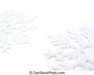Two Snowflakes - Two white snowflakes on a white background