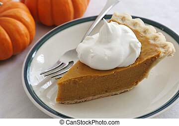 Pumpkin Pie Slice With Fork - A slice of pumpkin pie with...