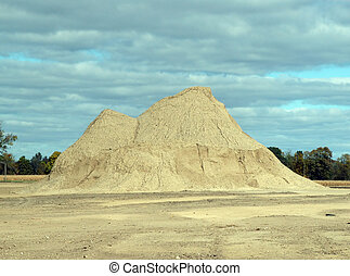 sand pile - large pile of sand with cloudy background