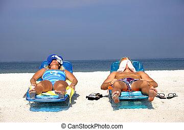 Sunbathing Couple - Couple sunbathing on the beach