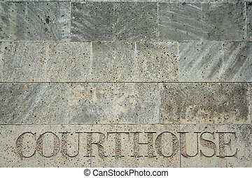 Courthouse in Stone - courthouse engraving on stone wall,...