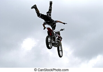 No Hands - Motocross jumper flys through air with no hands...
