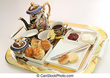 Cream tea 1 - A gilt-edge tray with an English cream tea,...