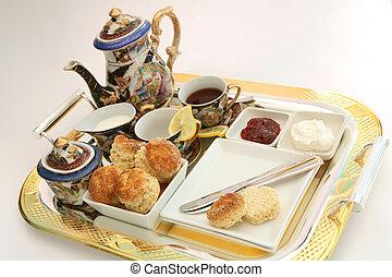 Cream tea 1 - A gilt-edge tray with an English cream tea,...