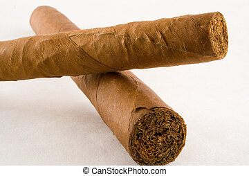 cuban cigars - two handmadee cuban cigars isolated on white...